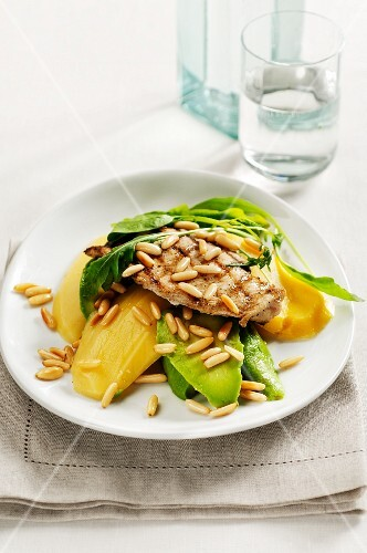 Chicken with mango and pinenuts