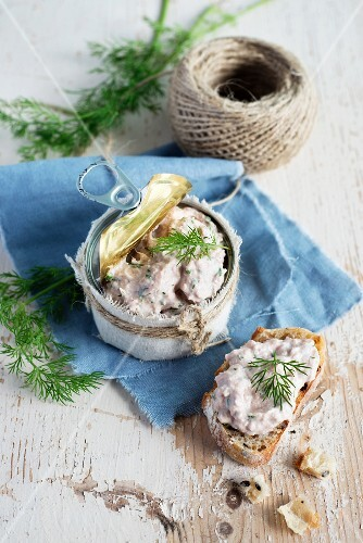Tuna rillette on bread and in a jar