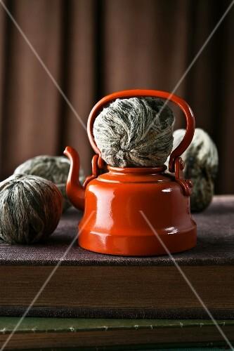 Green tea balls and a teapot