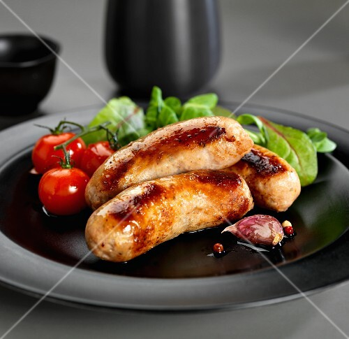 Pork sausages with vine tomatoes, garlic and lettuce