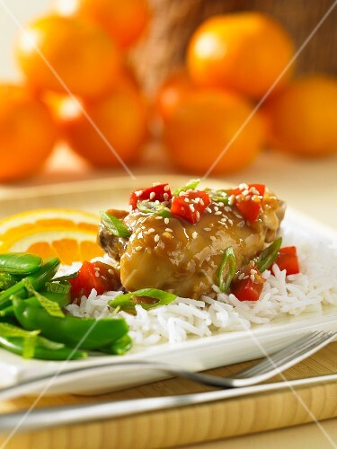 Chicken with hoisin and orange sauce on a bed of rice