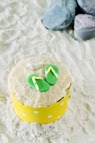 A cupcake decorated with flip-flops