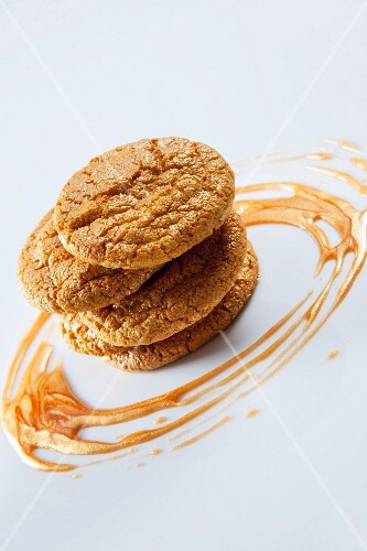 A stack of cookies with caramel sauce
