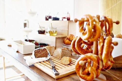 Bread, pretzels and jam on a breakfast buffet