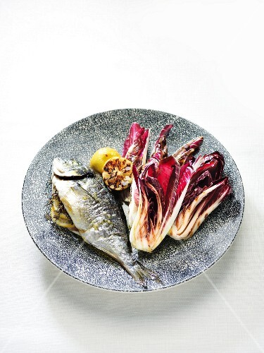 Grill radicchio with lemon oil and a fish filled with lemon and thyme