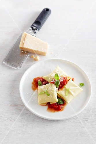 Ravioli with tomato sauce and Parmesan
