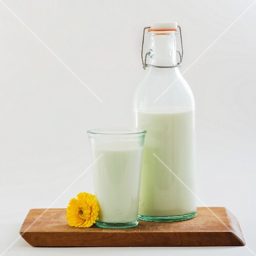 Organic milk in a bottle and in a glass