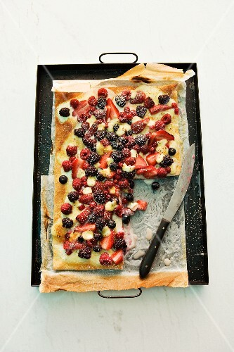 A sweet berry pizza on a baking tray