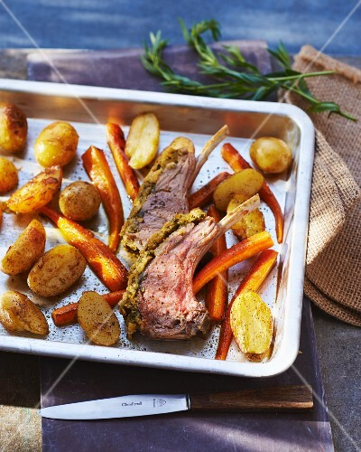 Loin rack joint of lamb with a herb crust and roasted vegetables