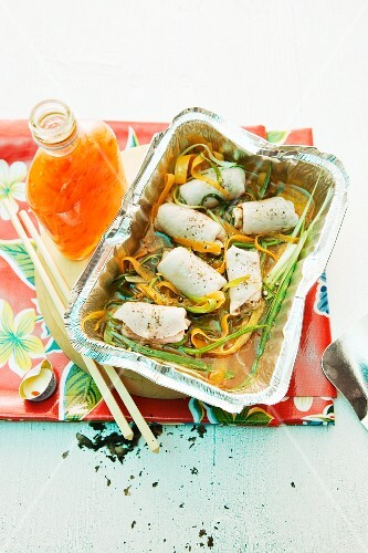 Steamed pork rolls with ginger and plums