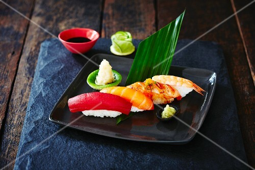 Various nigiri sushi with wasabi and ginger (Japan)