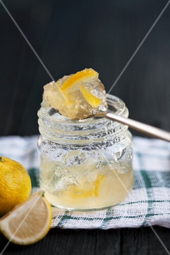 Yuzu jelly in a jam jar and on a spoon