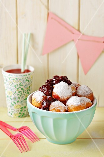Doughnuts with a red wine and sour cherry sauce