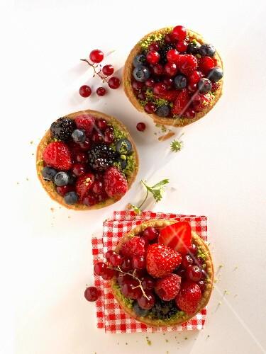 Three summery berry tarts