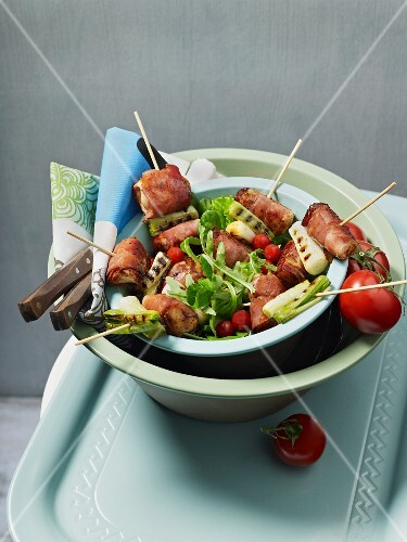 Skewers with vegetables and chicken wrapped in bacon