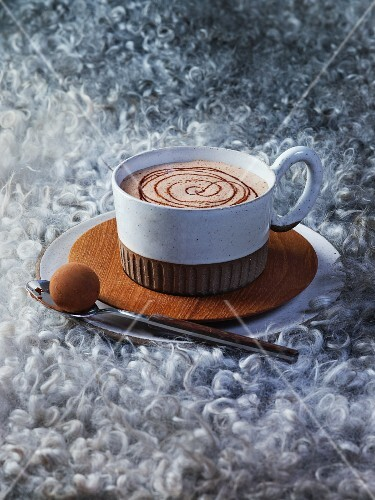 Cup of hot chocolate with a milk chocolate praline