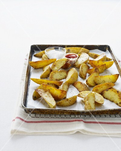 Potato wedges on a baking tray