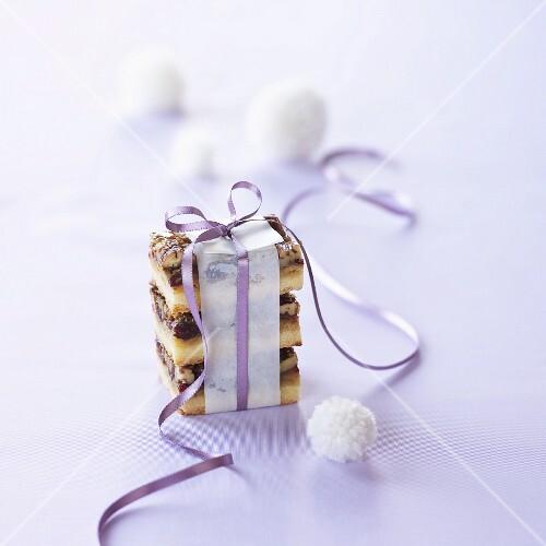 Cranberry and nut bars tied with a purple ribbon