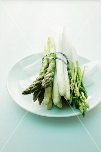 Green and white and wild asparagus bundled together
