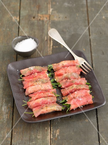 Beef rolls with horseradish cream and rocket