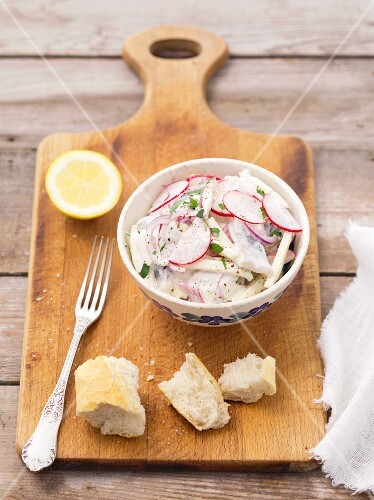 Herring and apple salad with red onions, radishes and cream