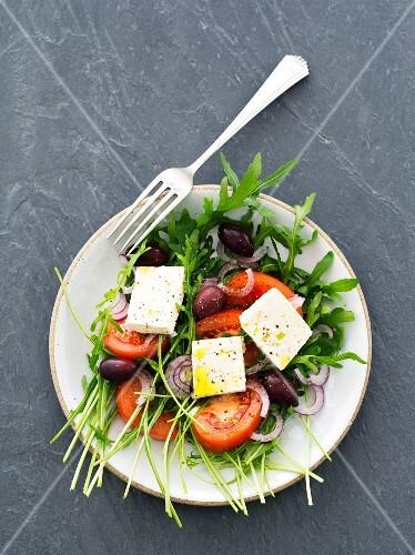 Rocket salad with tomatoes, feta and kalamata olives