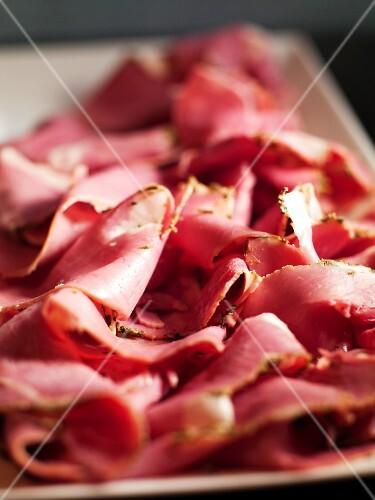 A platter of sliced ham