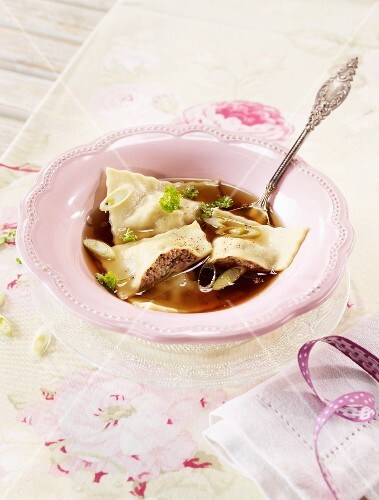 Consomme with venison ravioli