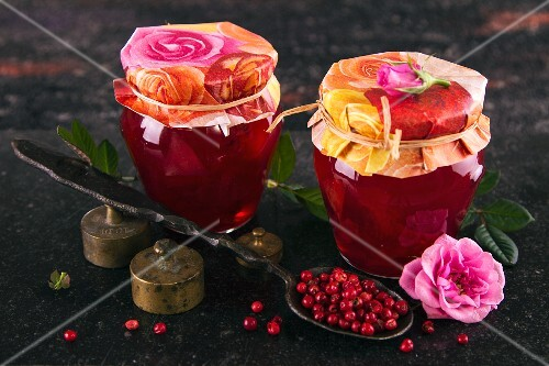 Two jars of rose petal jelly with cranberries