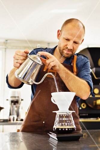 A man pouring coffee
