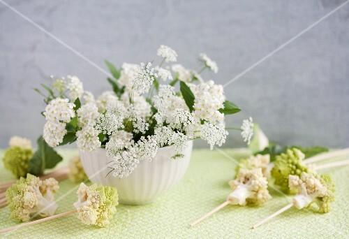 Arrangement of romanesco cauliflower, spirea and chervil