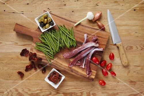 Ingredients for lamb filllet with green beans, olives and tomatoes