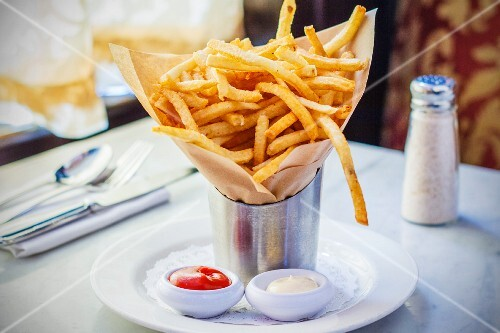 French fries in a paper bag, ketchup and mayonnaise