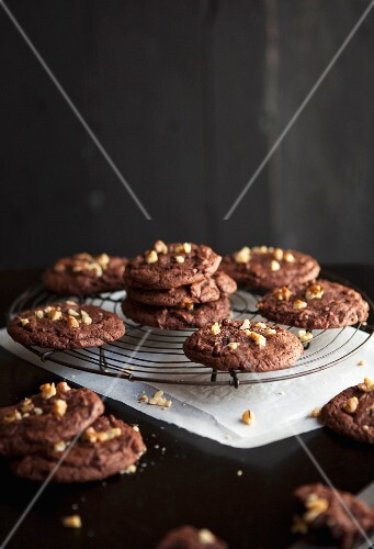 Brownie cookies with chopped walnuts on a wire rack