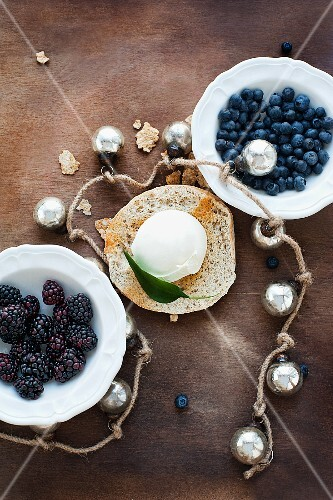 Blueberries, blackberries, a scoop of ice cream and Christmas baubles