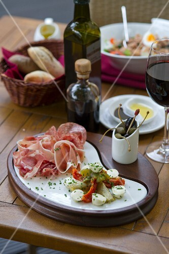 A selection of antipasti with red wine (Italy)