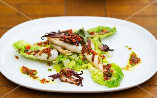 Grilled squid with vinaigrette on a bed of lettuce