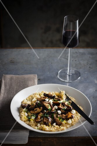Mushroom risotto and a glass of red wine