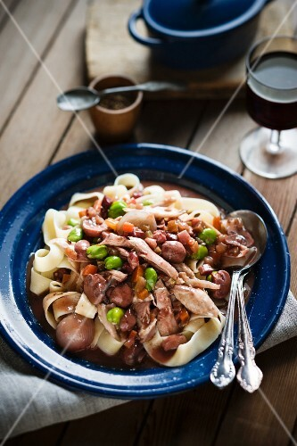 Coq au vin with pappardelle and broad beans