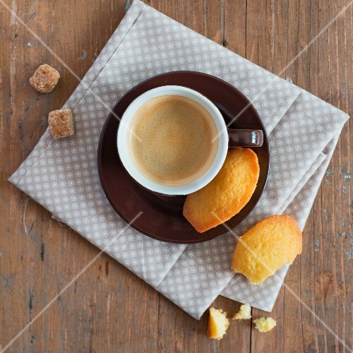 A cup of coffeee and madeleines