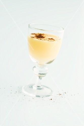 A cream dessert in a glass