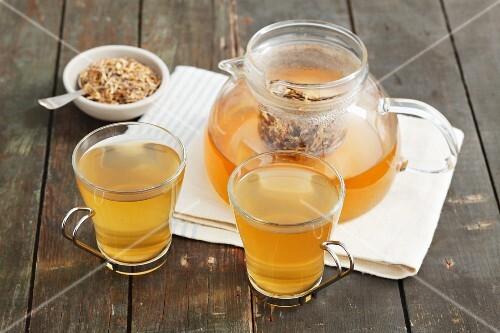 Wheatgrass root tea and dried tea leaves
