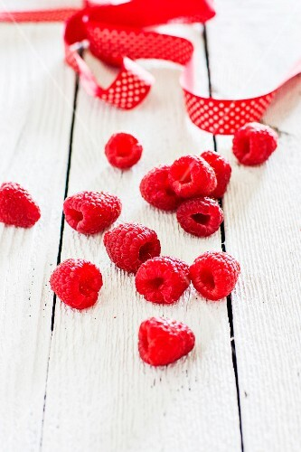 Raspberries on a white surface
