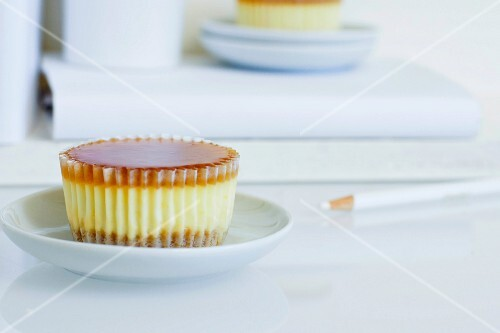 A cheesecake cupcake with an apricot glaze