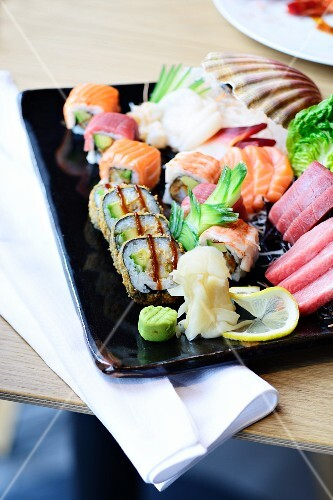 A sushi platter with sashimi in a restaurant