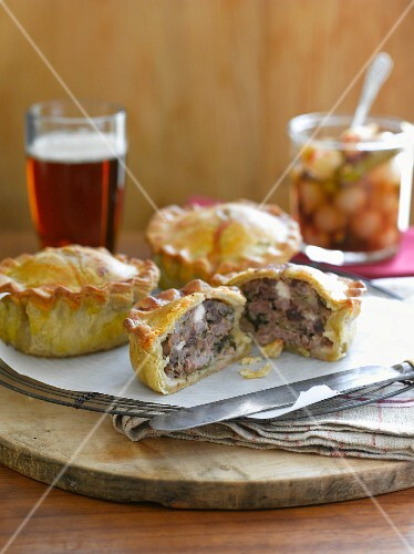 Game pie with pickles and a glass of beer