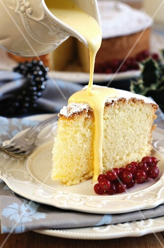 Zabaglione sauce being poured over a slice of Angel Food cake