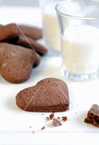 Heart-shaped chocolate biscuits and glasses of milk for Valentine's Day