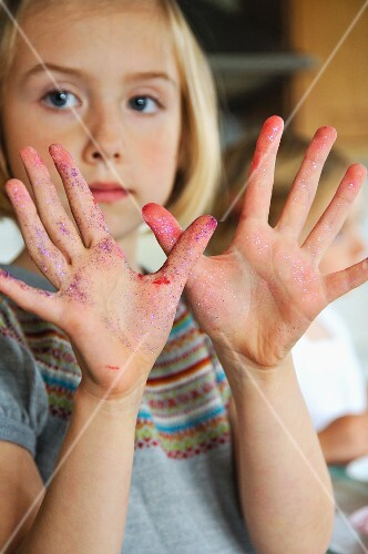 A girl showing smeared hands