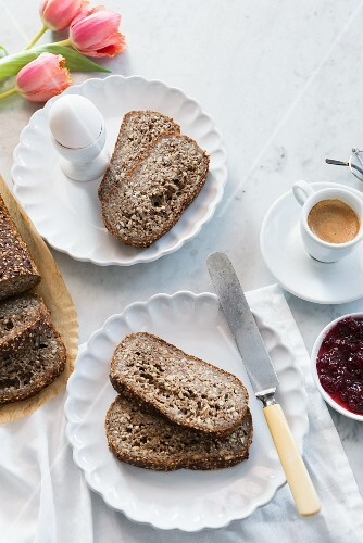 Gluten free bread, coffee, a soft-boiled egg and jam